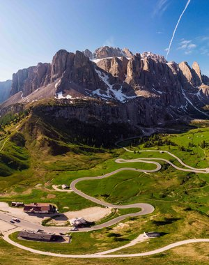 Aerial top view from drone to wonderful alpine landscape and meadows at Pass Gardena with majestic Sella mountain group in Dolomiti. Alps, South Tirol, Dolomites mountains, passo di Val Gardena, Italy